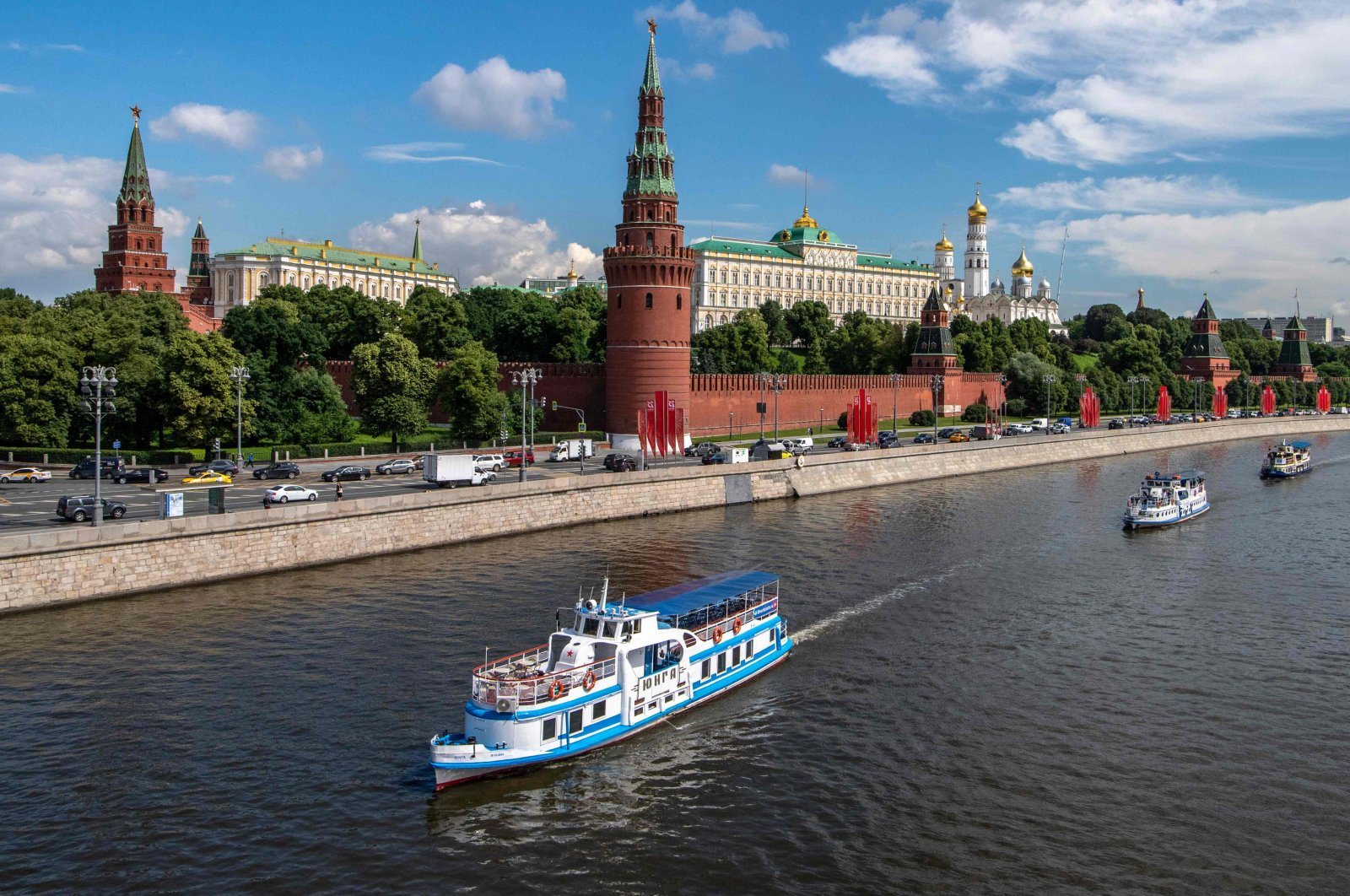 Tourist boat parade on the Moskva river to mark the beginning of the navigation season in the Russian capital, which was postponed due to the coronavirus pandemic, on June 23, 2020. (AFP Photo)