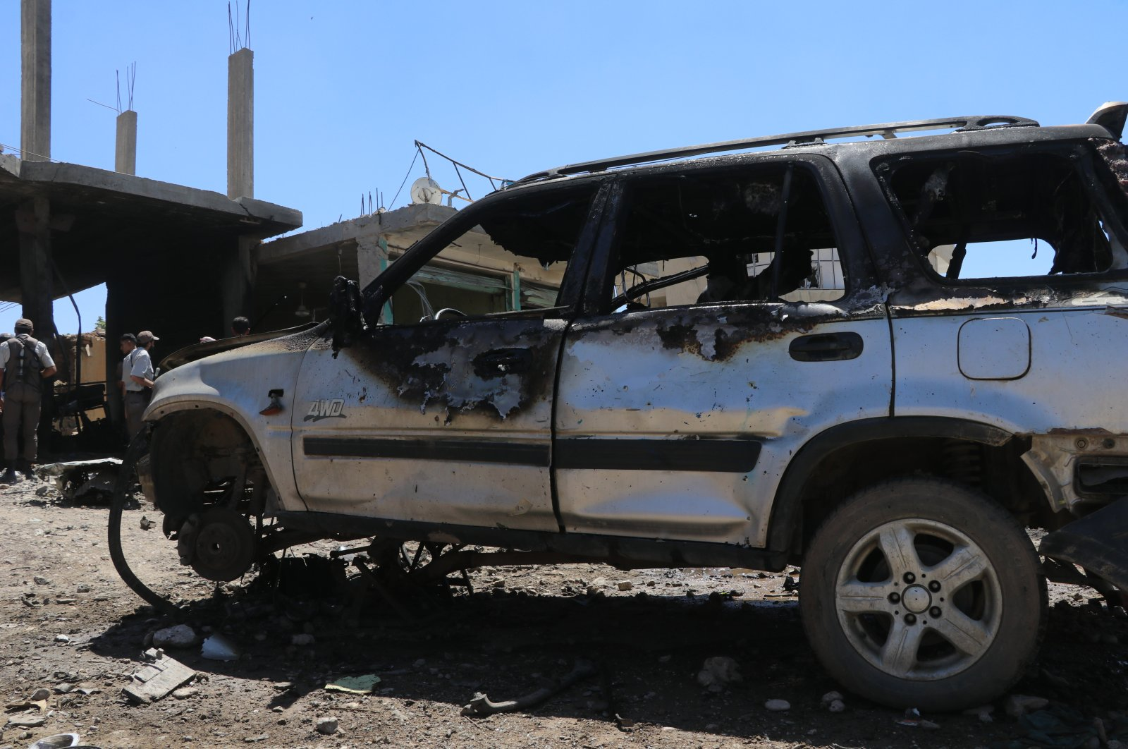 A car damaged by a YPG/PKK terrorist attack in Syria's Tal Hafar, June 23, 2020. (AA Photo)