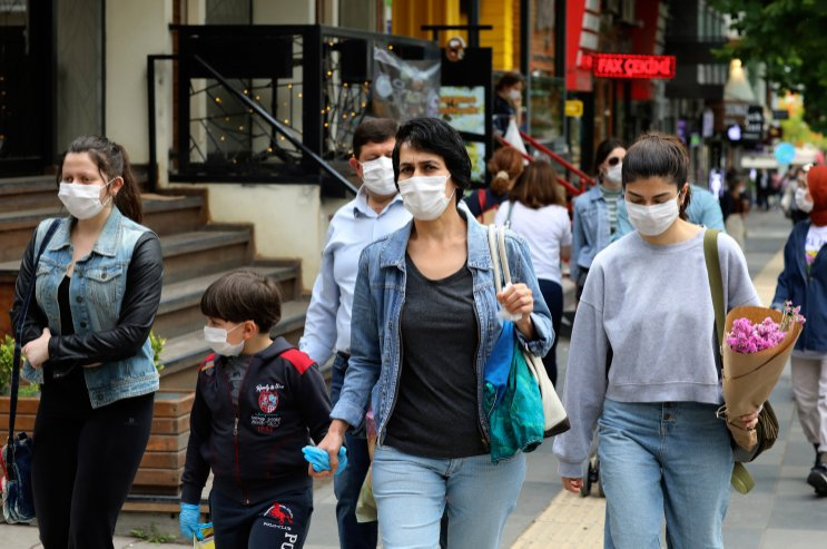 People wearing face masks to protect against the spread of coronavirus, walk in the city center, in Ankara, Turkey, June 20, 2020. (AP Photo)