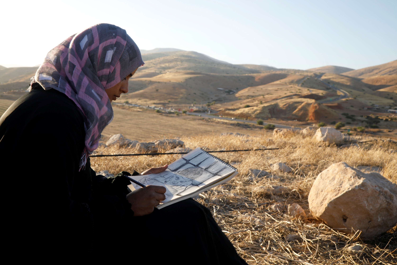 Khadeeja Bisharat draws in Jordan Valley in the Israeli-occupied West Bank June 18, 2020. (Reuters Photo)