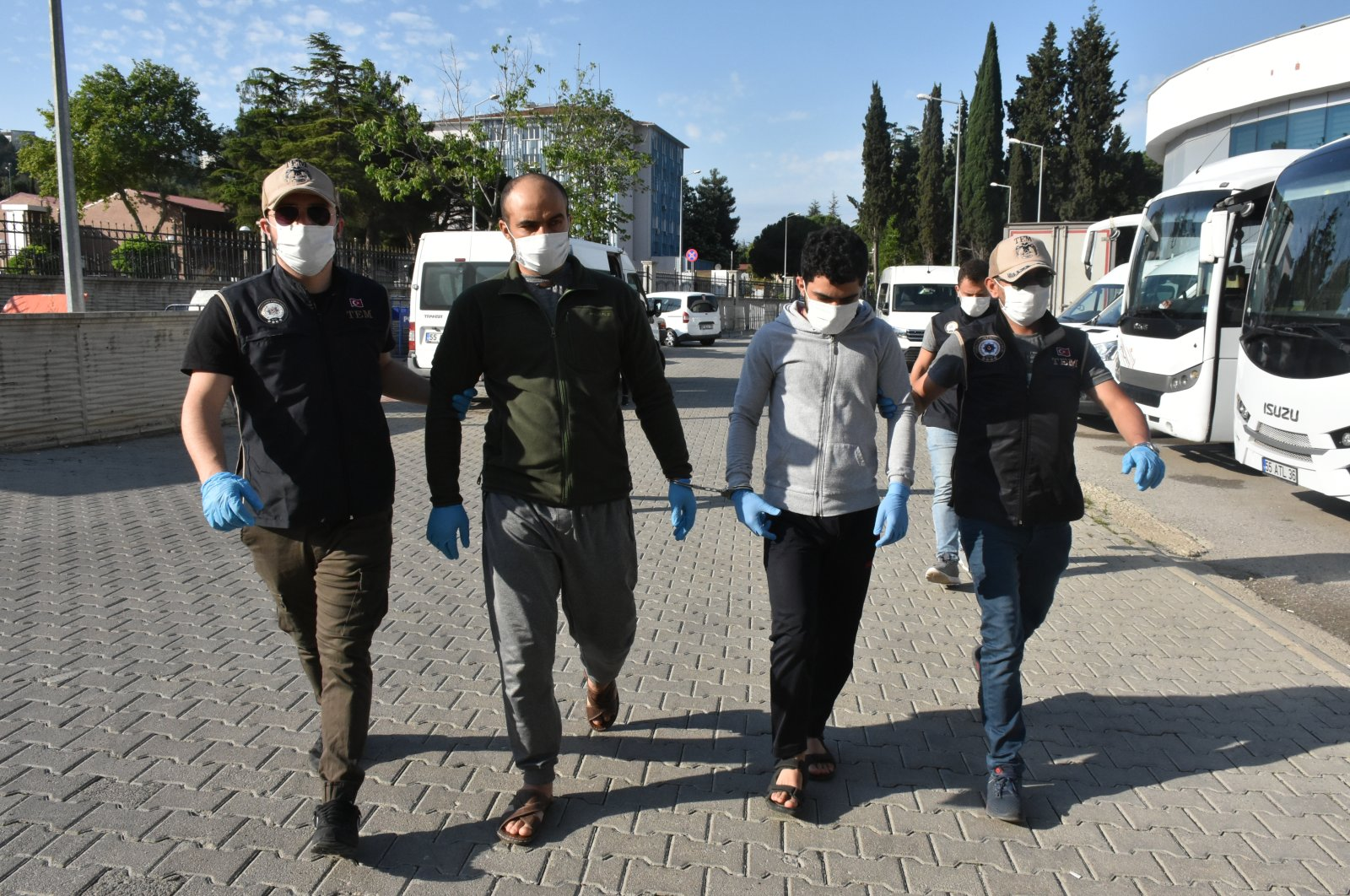 Police bring detained suspects to the security directorate in Samsun province on June 24, 2020 (AA Photo)