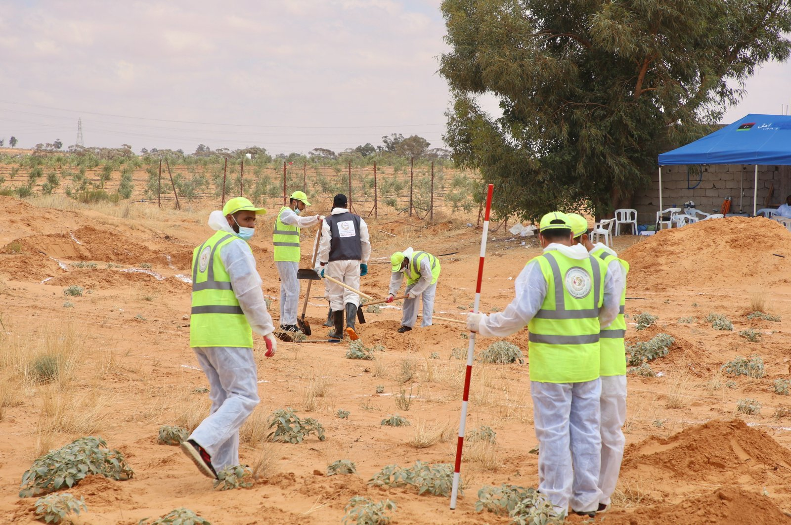 Libyan officials conduct excavation work at a mass grave in an area formerly held by the putschist Gen. Khalifa Haftar, Tarhuna, June 24, 2020. (AA Photo)