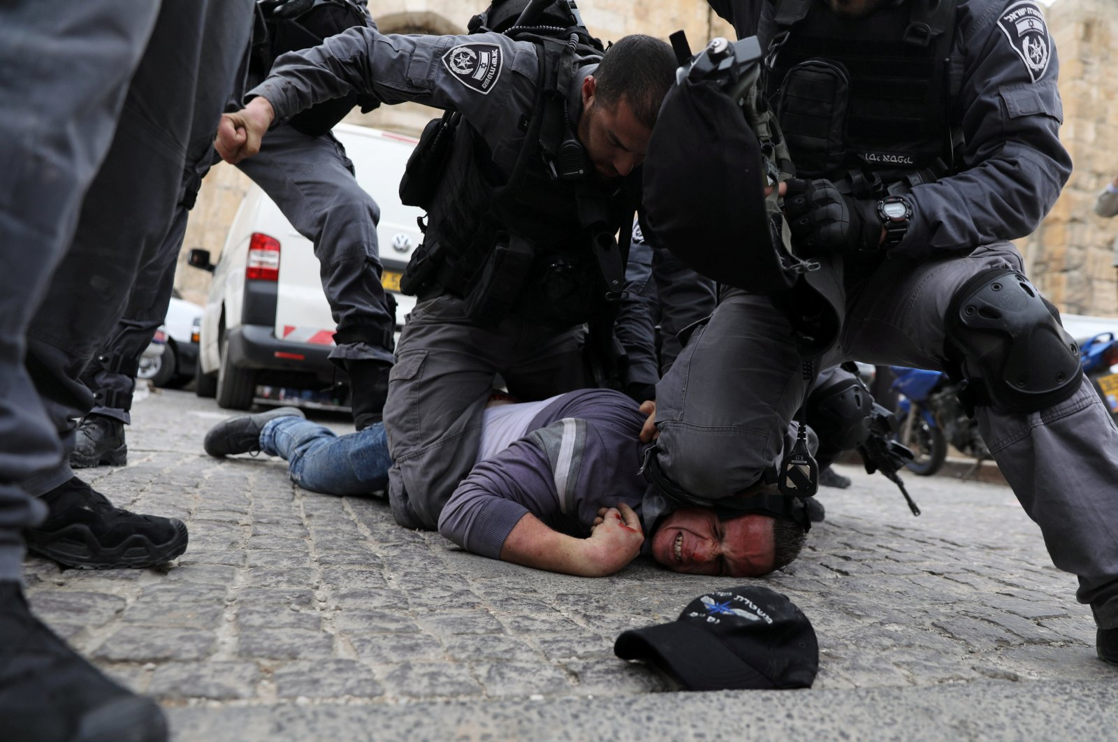 Israeli police officers detain a Palestinian protestor during scuffles outside the compound housing al-Aqsa Mosque in Jerusalem's Old City, March 12, 2019. (Reuters Photo)