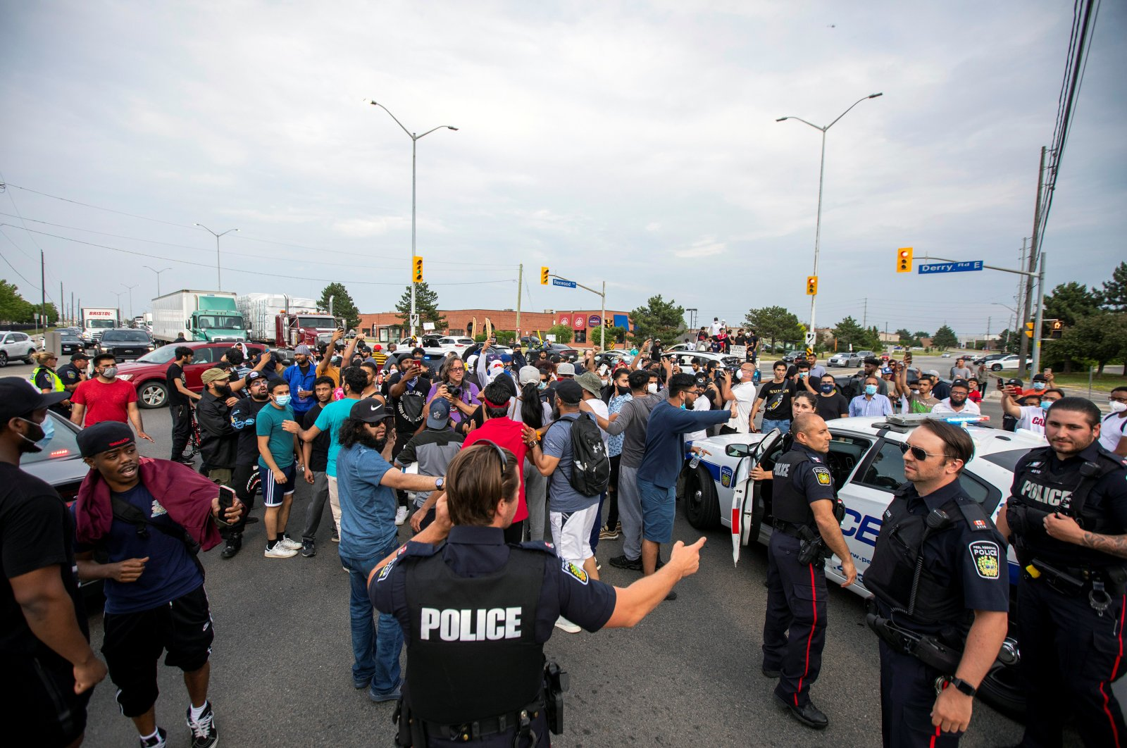 Protesters vent at police while demonstrating against the June 20 fatal shooting by Peel Regional Police of Ejaz Ahmed Choudry, 62, who family members say suffered from schizophrenia, in Malton, Ontario, Canada, June 22, 2020. (Reuters Photo)