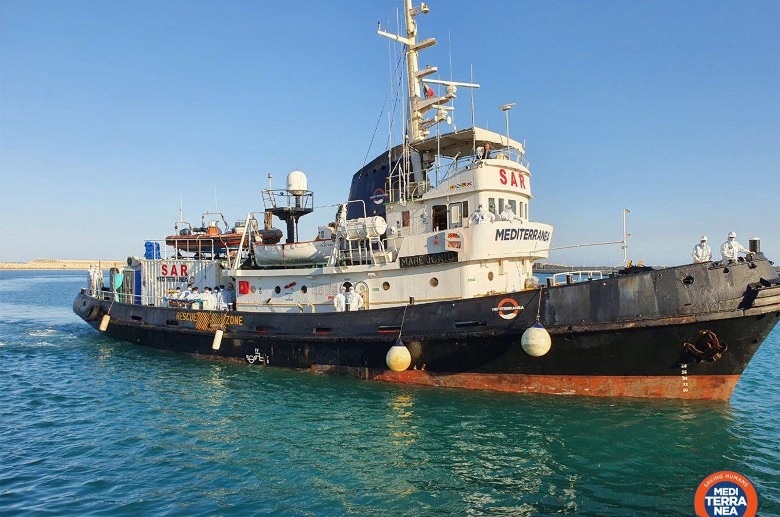 The leftist Italian charity Mediterranea's rescue vessel Mare Ionio transports migrants on board as it arrives to berth in Pozzallo, southern Sicily, June 20, 2020. (AFP Photo/ Mediterranea/ Handout)