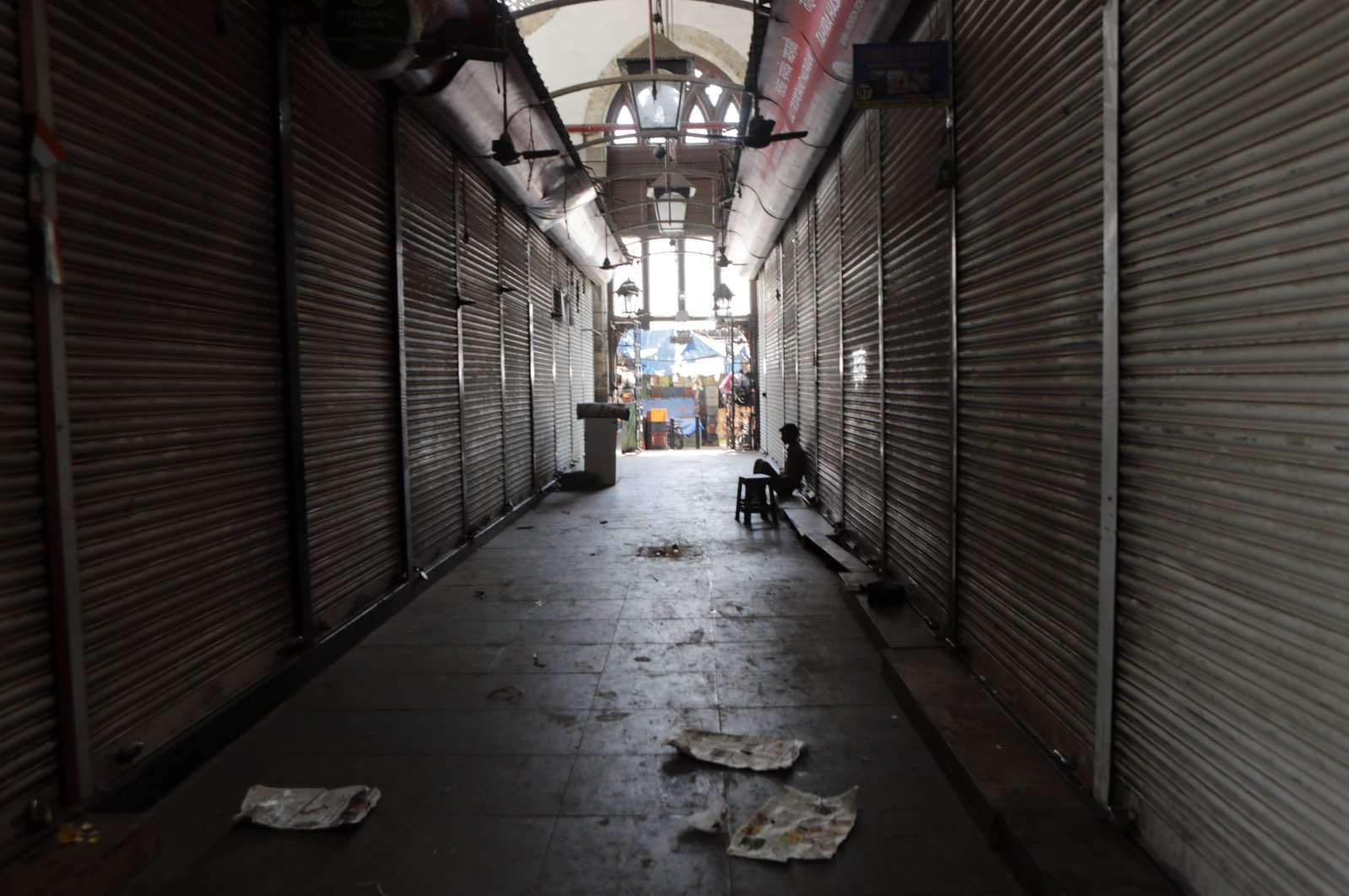 A man sits outside a closed wholesale market in Mumbai, India, March 24, 2020. (AP Photo)