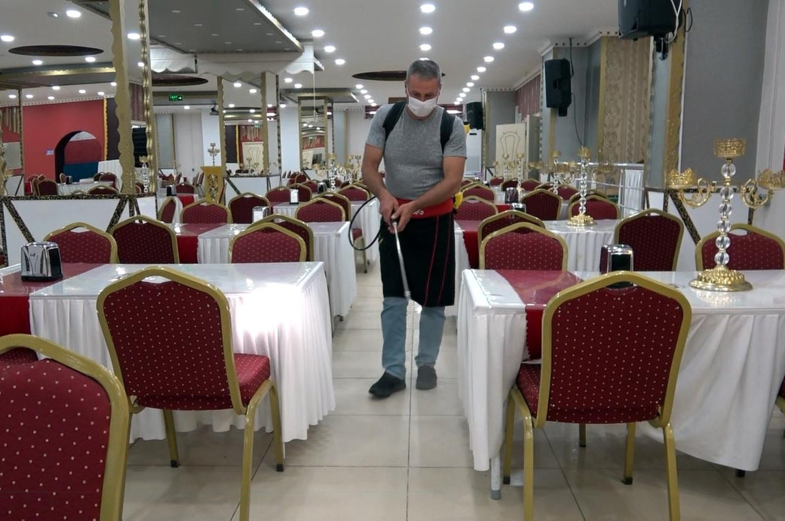 A worker disinfects a wedding hall in the Erciş district, in Van, Turkey, June 19, 2020. (DHA Photo)
