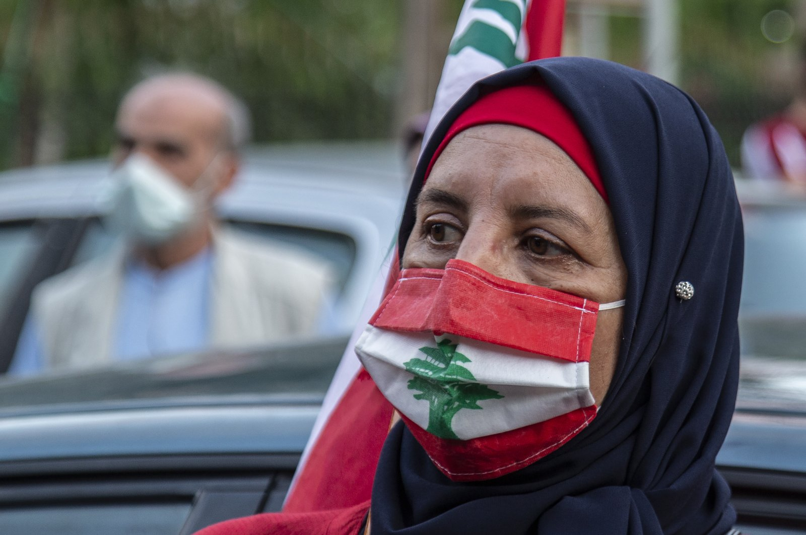 A participant wears a Lebanon flag-themed face mask as she attends a rally in front of the Lebanese interior ministry during a protest over the economic and financial crisis, in al-Hamra area of Beirut, Lebanon, May 29, 2020. (EPA Photo)
