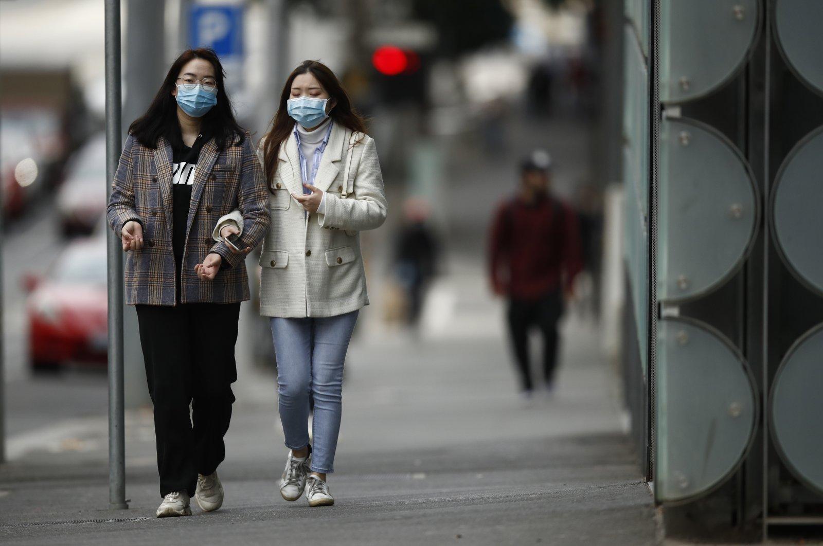 Women wearing masks walk around Melbourne, Australia, June 25, 2020. (EPA Photo)