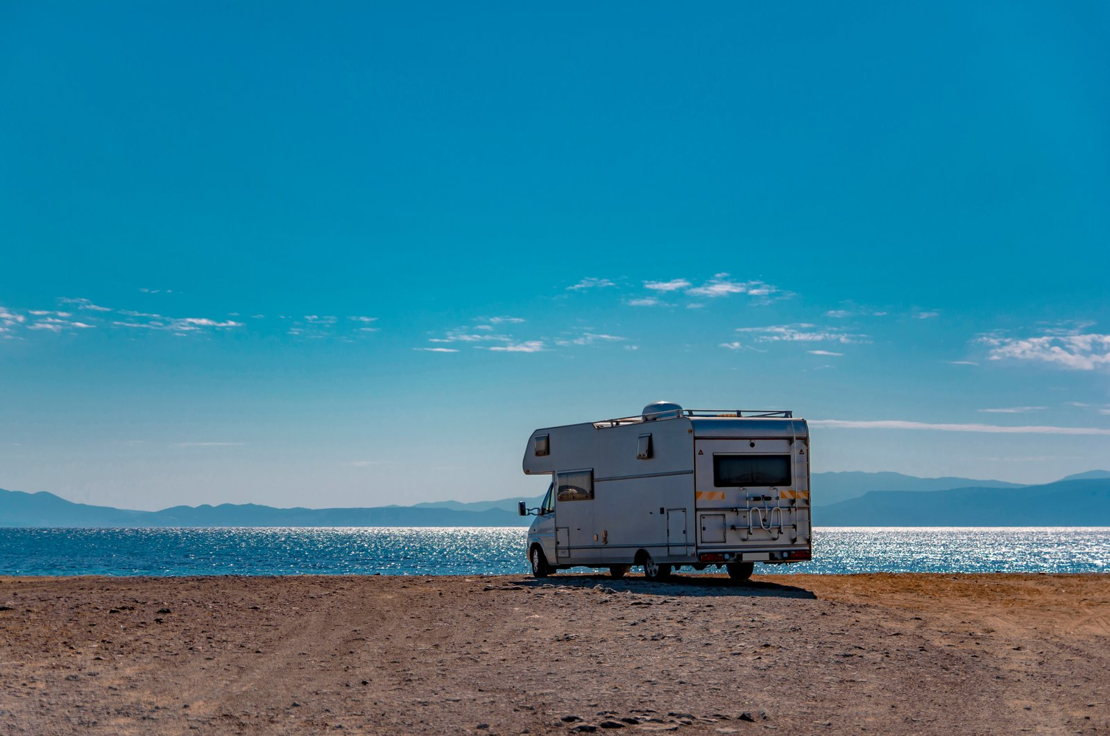 Park your car or caravan in the designated camping areas and then go for a swim in Ayvalık. (Shutterstock Photo)
