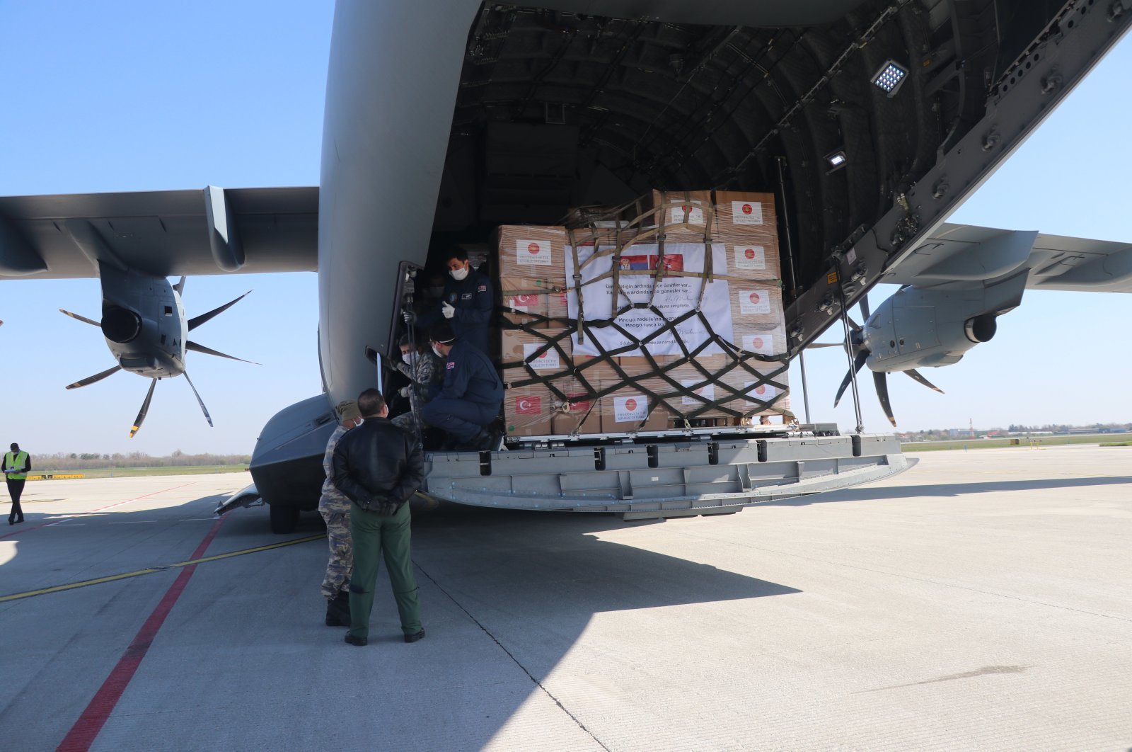 A military cargo plane carrying medical equipment from Turkey to Serbia lands in the Serbian capital Belgrad, April 10, 2020. (AA Photo)