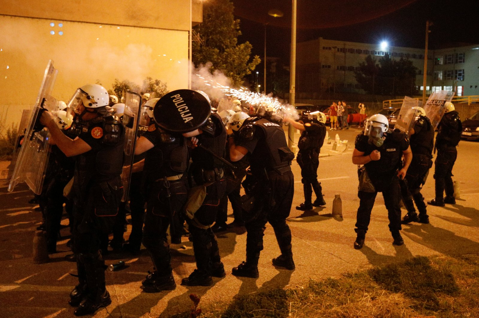 Riot police fire tear gas in front of a police station in Podgorica, Montenegro, June 24, 2020. (Reuters Photo)