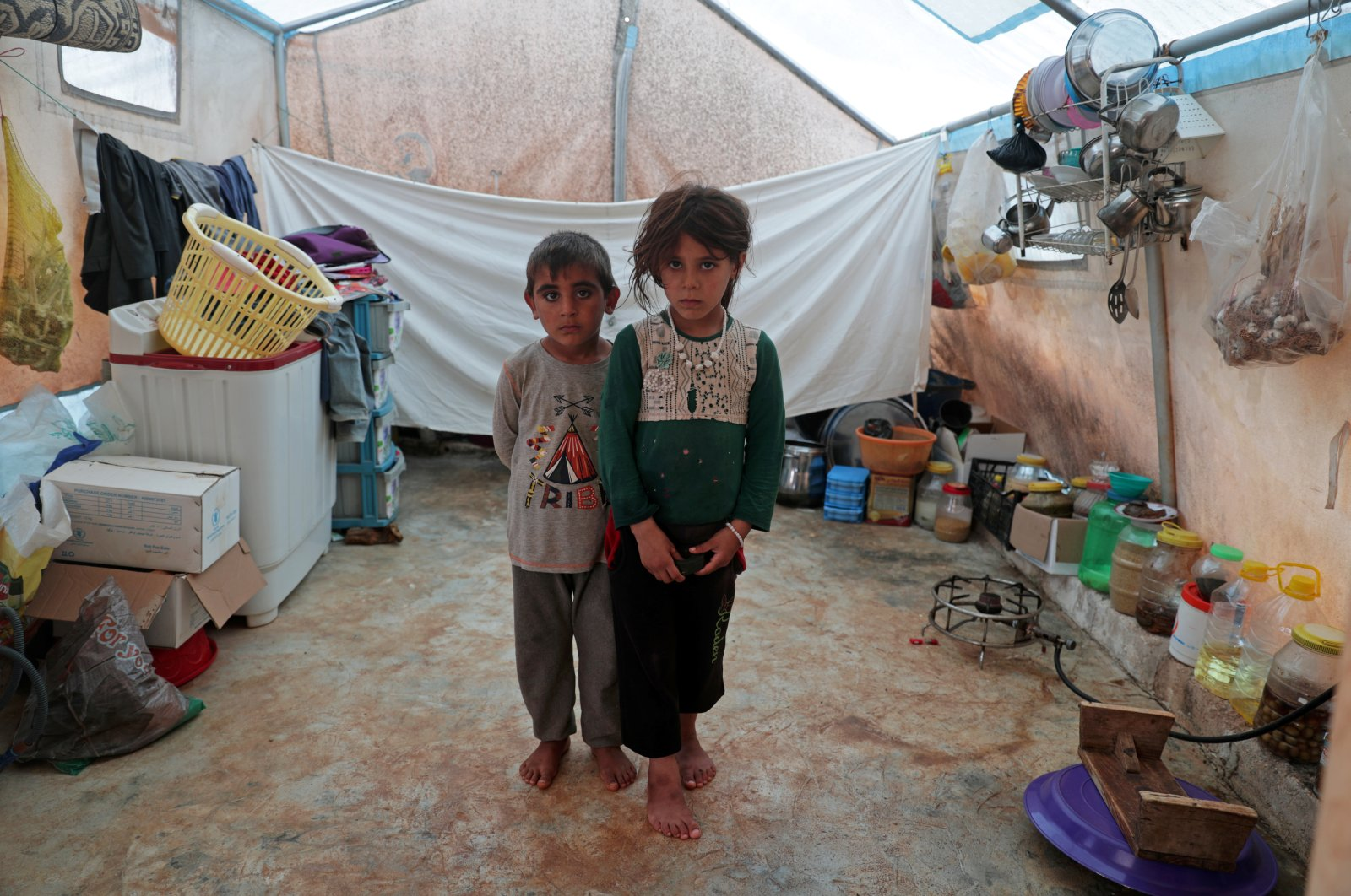 Jumana and Farhan al-Alyawi, displaced Syrian twins from east Idlib, pose for a picture in a tent at Atmeh camp, near the Turkish border, June 19, 2020. (REUTERS Photo)
