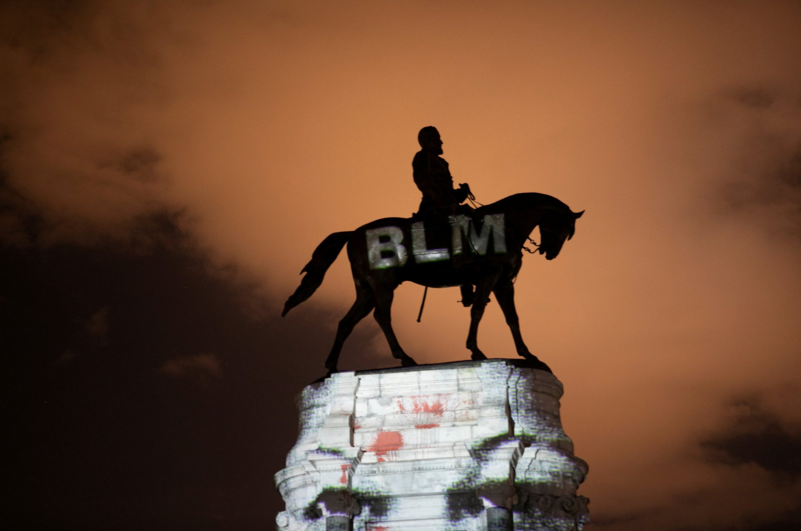 Artist Dustin Klein projects a Black Lives Matter image onto the statue of Confederate Gen. Robert E. Lee in Richmond, Virginia, U.S., June 18, 2020. (Reuters Photo)