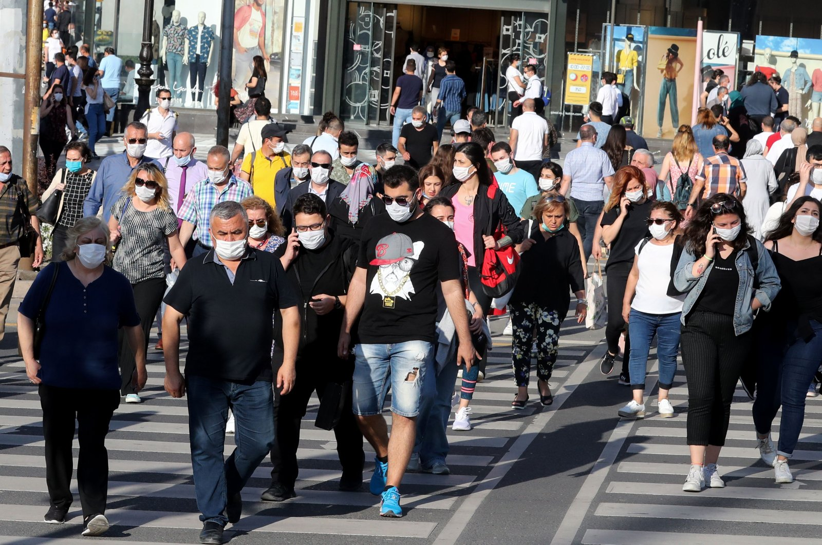 People wear protective face masks, in Ankara, Turkey, June 24, 2020. (AFP Photo)