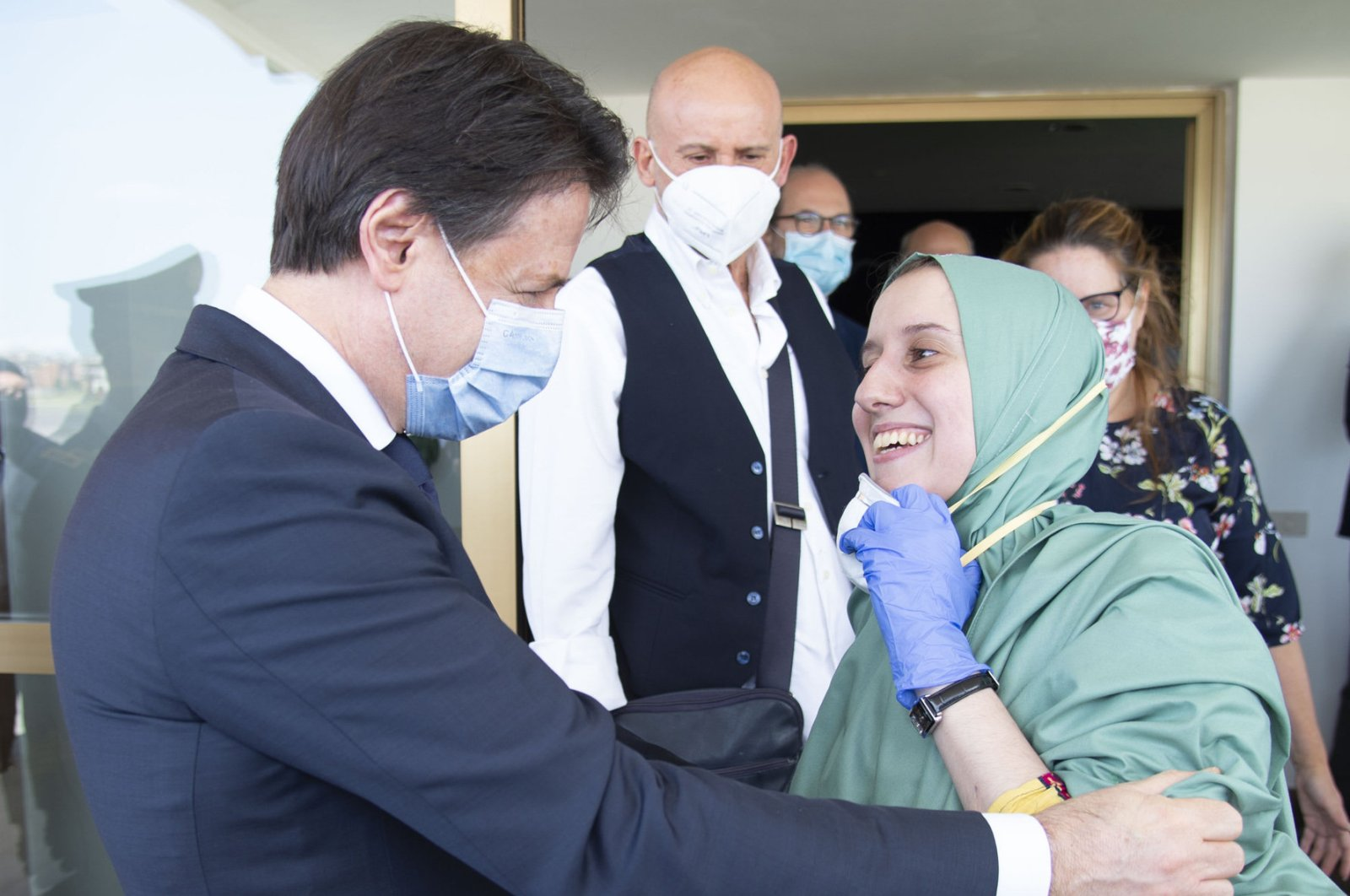 Silvia Romano, who was kidnapped 18 months ago in East Africa, is welcomed by Italian Prime Minister Giuseppe Conte in Rome, May 13, 2020. (AA)