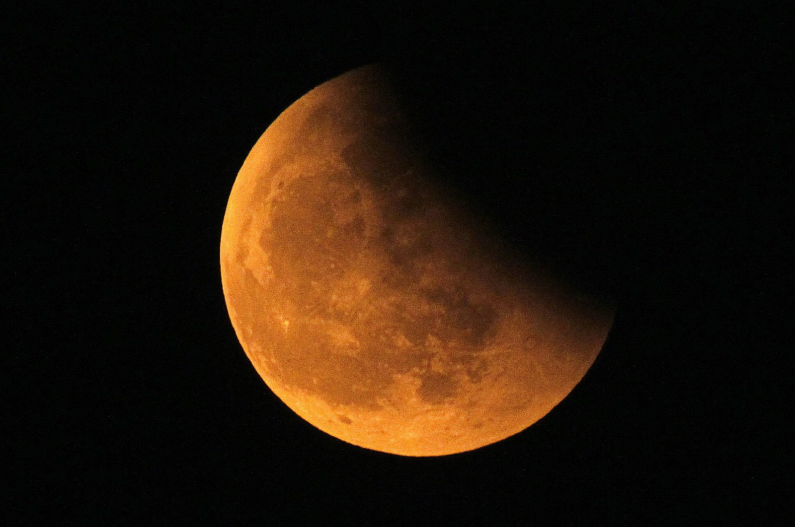 The shadow of the Earth is seen on the Moon during a total lunar eclipse, Shanghai, Dec. 21, 2010. (Reuters File Photo)