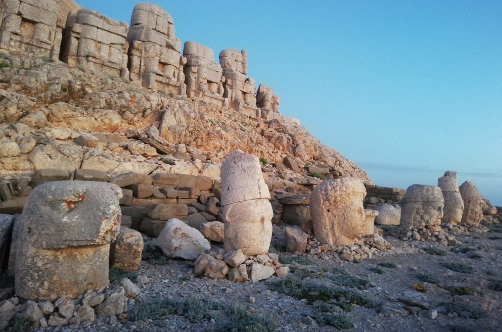 Sculptures of Persian and Greek gods on Mount Nemrut's east terrace. (Paris Achen / Daily Sabah)