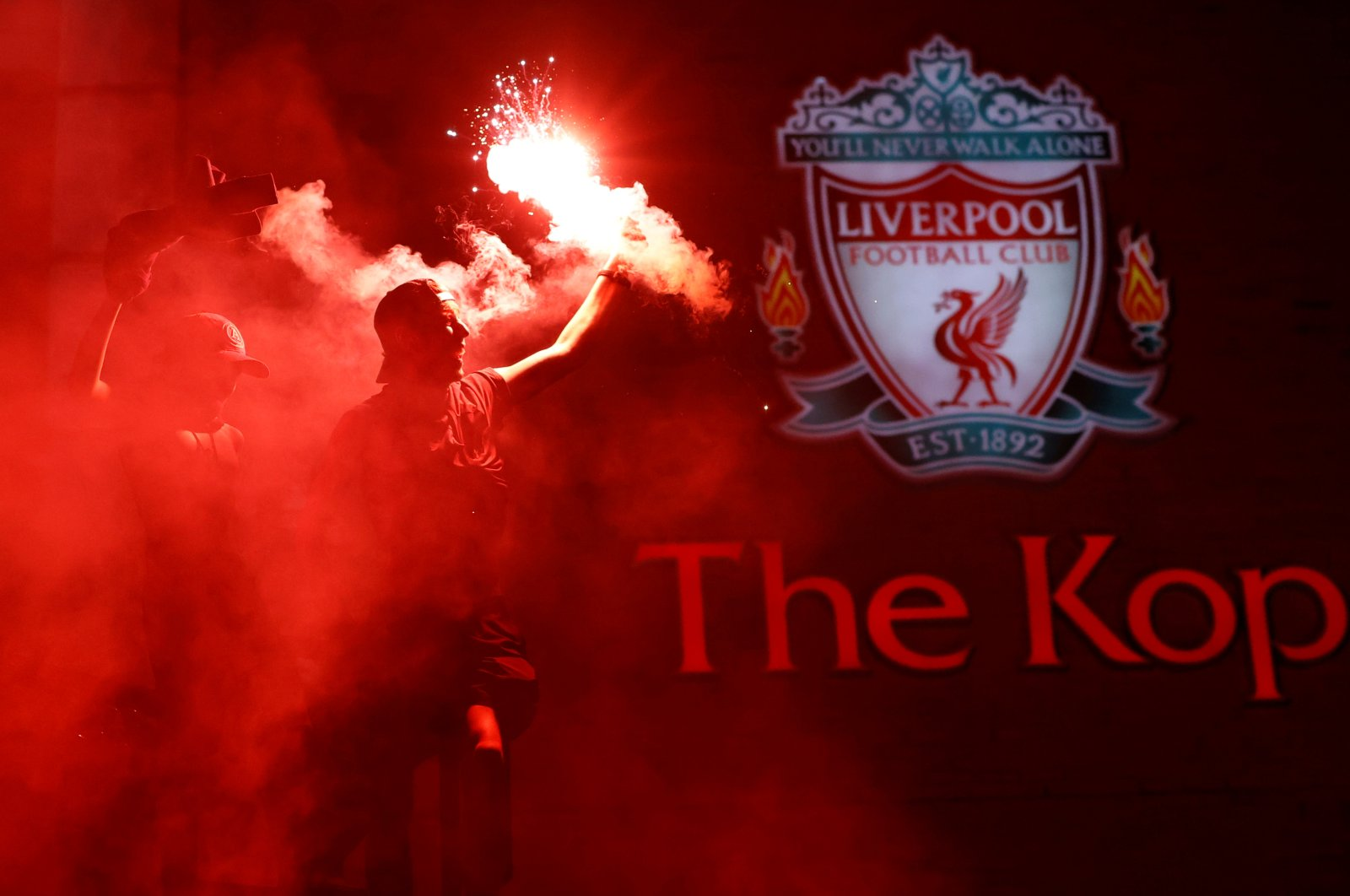 Liverpool fans celebrate winning the Premier League with flares outside Anfield stadium in Liverpool, Britain, June 25, 2020. (Reuters Photo)