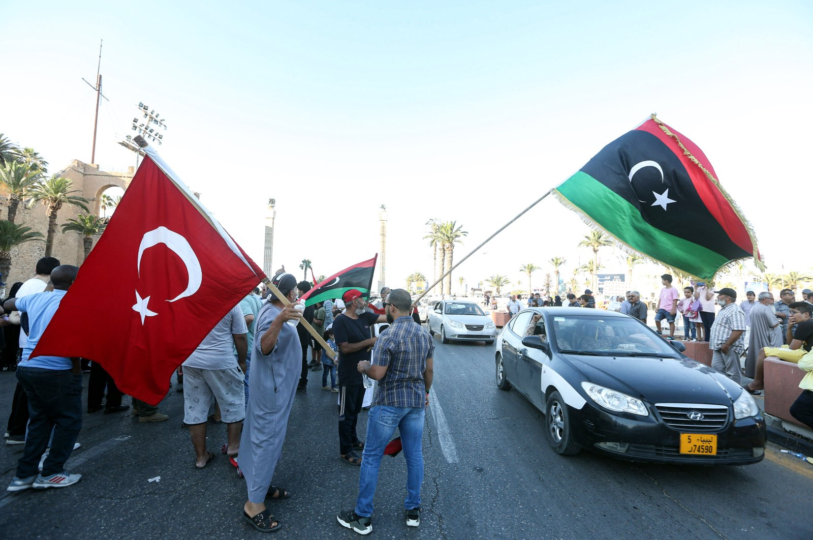 People wave flags of Libya and Turkey during a demonstration in the Martyrs' Square in the center of the Libyan capital Tripoli, currently held by the U.N.-recognized Government of National Accord (GNA), June 21, 2020. (AFP Photo)