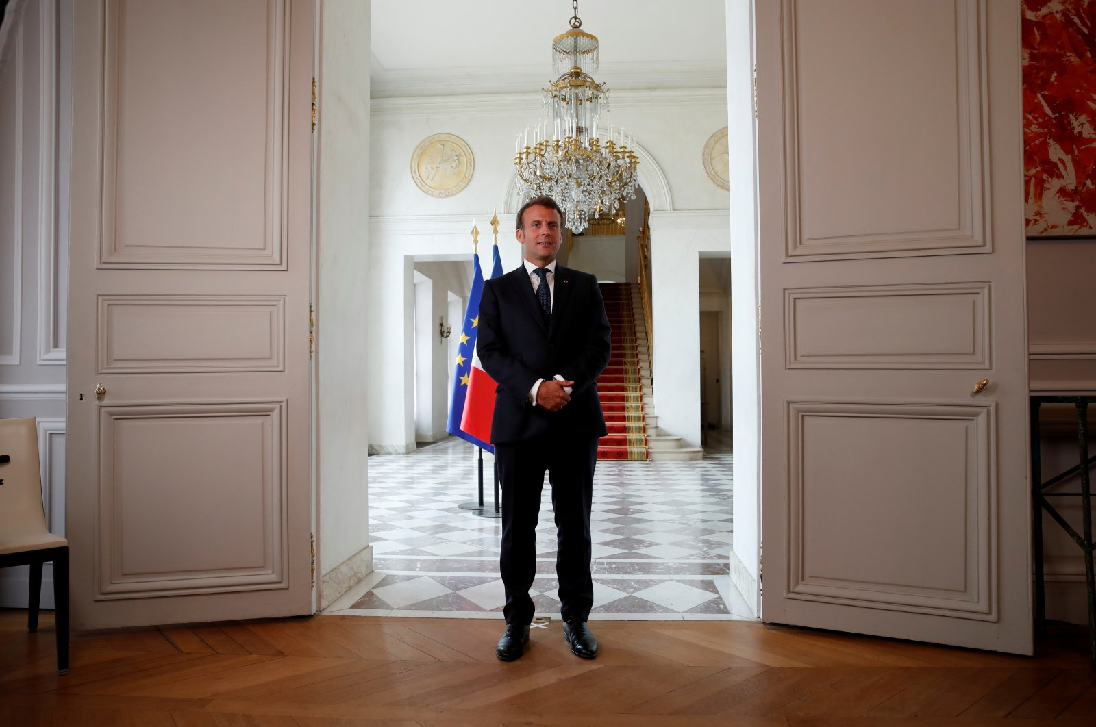 French President Emmanuel Macron arrives to deliver a statement after an international videoconference on vaccination at the Elysee Palace in Paris during the outbreak of the coronavirus disease in France, May 4, 2020. (Reuters Photo)