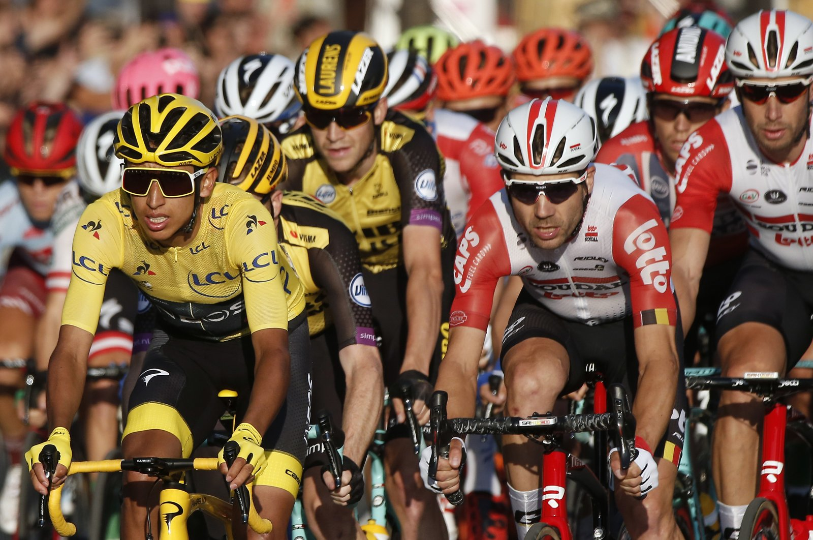 Egan Bernal (L) wearing the overall leader's yellow jersey, races on the Champs Elysees during the Tour de France cycling race in Paris, France, July 28, 2019. (AP Photo)
