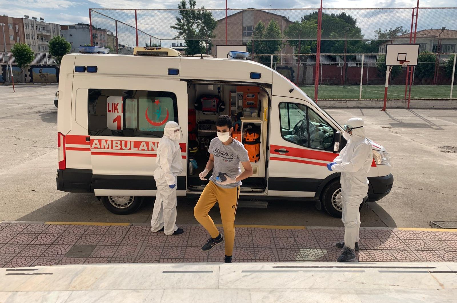 A student is brought by ambulance to a school for last week's high school admission exam in eastern Turkey's Adıyaman province, June 20, 2020. (AA Photo)