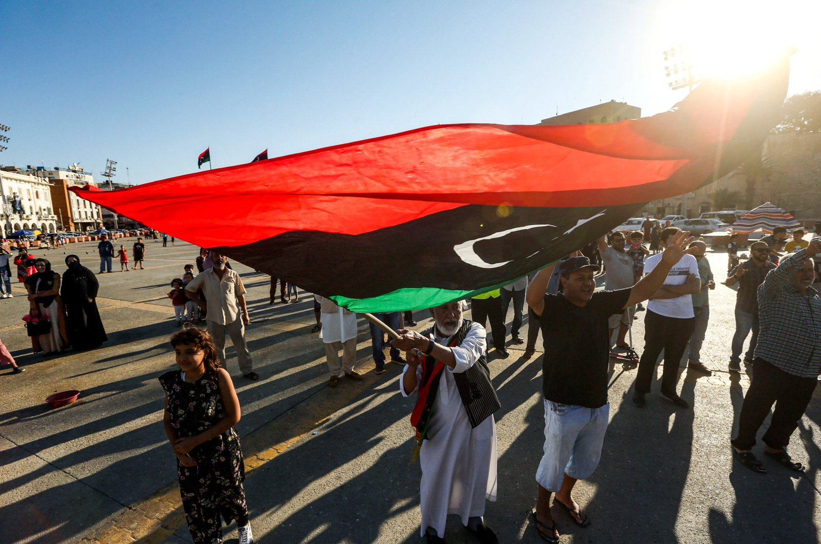 An elderly man waves a Libyan national flag during a demonstration in the Martyrs' Square in the centre of the Libyan capital Tripoli, June 21, 2020. (AFP Photo)