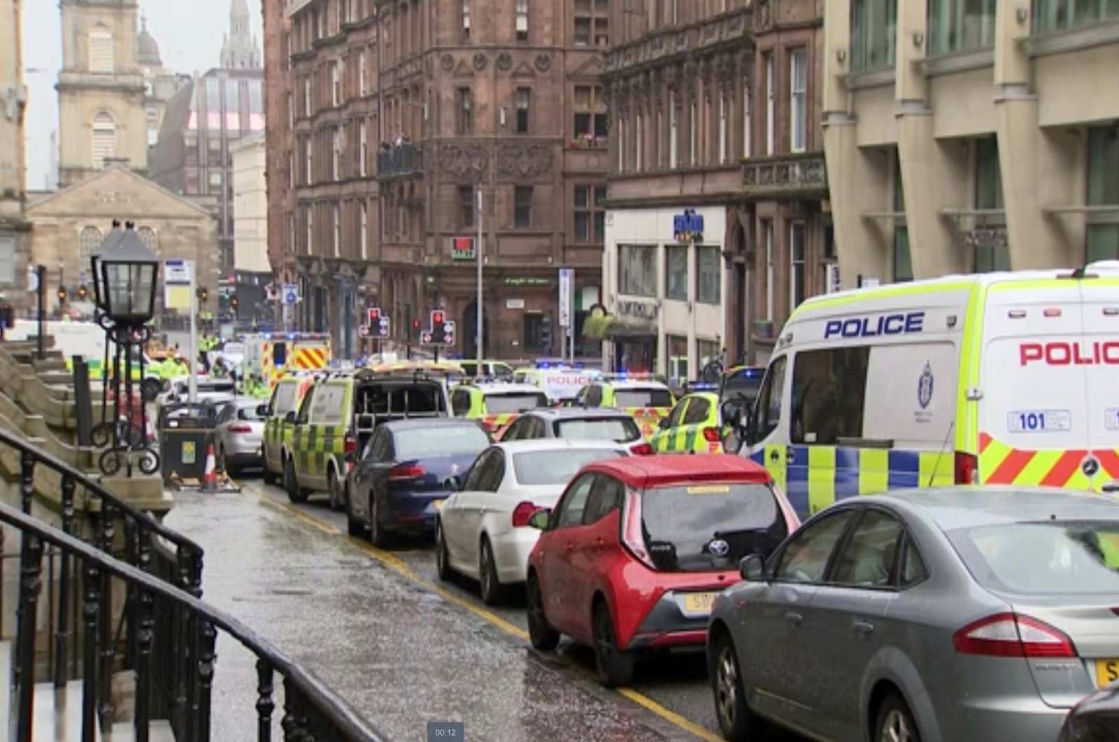 Emergency services attend the scene of incident, Glasgow, Scotland, June 26, 2020. (AP Photo)