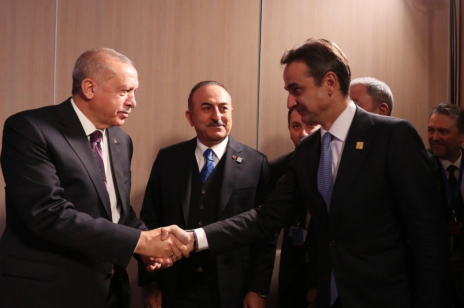 President Recep Tayyip Erdoğan (L) shake hands with Greek Prime Minister Kyriakos Mitsotakis during an event in Watford, Britain, Dec. 4, 2019. (AA Photo)