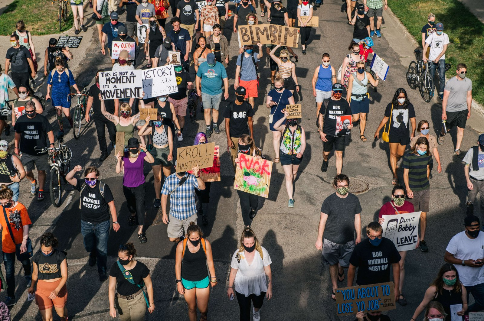 People march in the street, calling for Minneapolis Police Union Lt. Bob Kroll to be fired, in Minneapolis, Minnesota, June 25,2020. (AFP Photo)