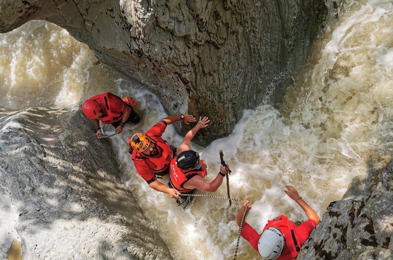 Search and rescue crews comb a river to find Derya Bilen, in Bursa, Turkey, June 24, 2020. (İHA Photo)