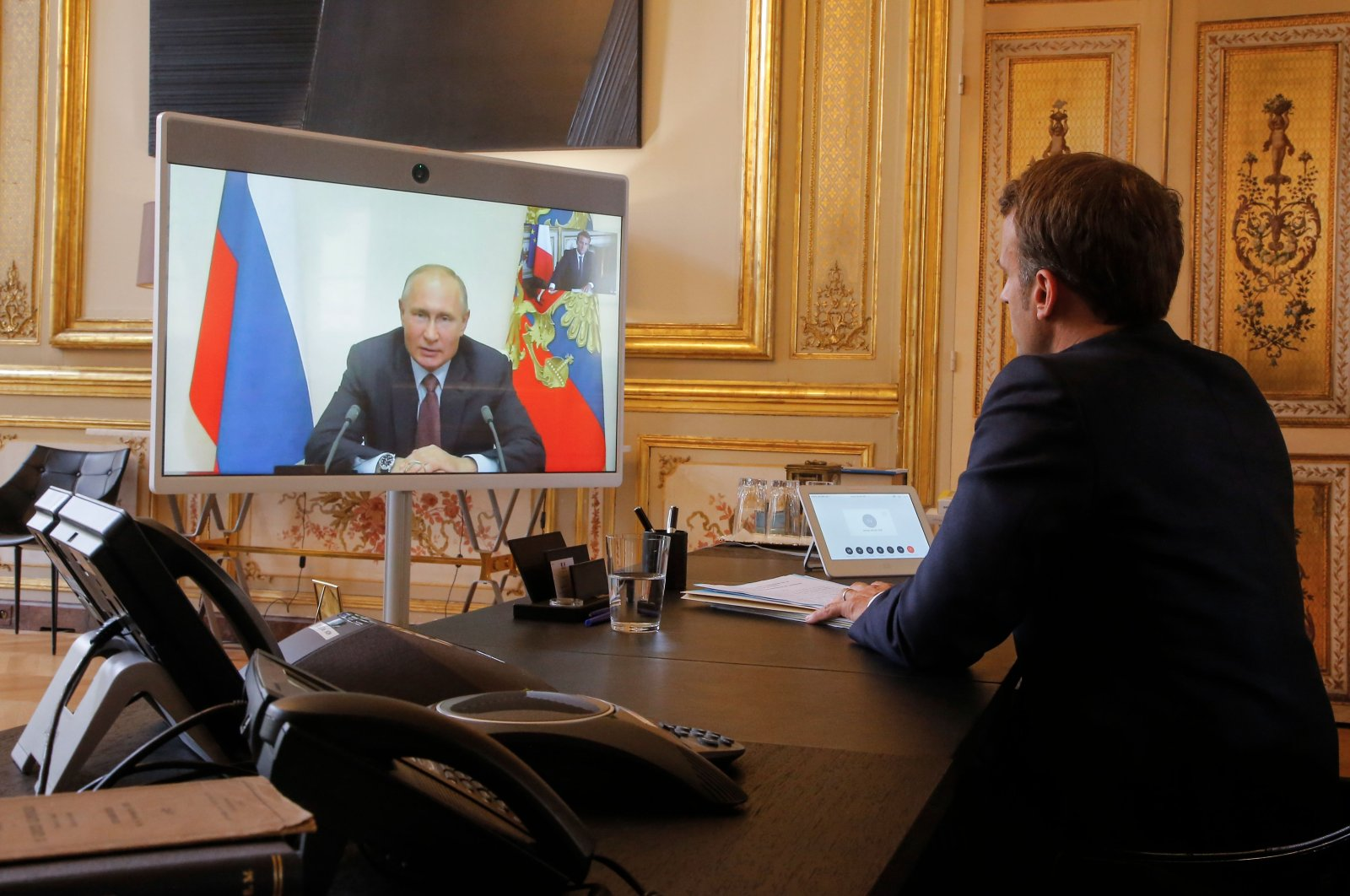 French President Emmanuel Macron talks to Russian President Vladimir Putin during a video conference on June 26, 2020. (AFP Photo)