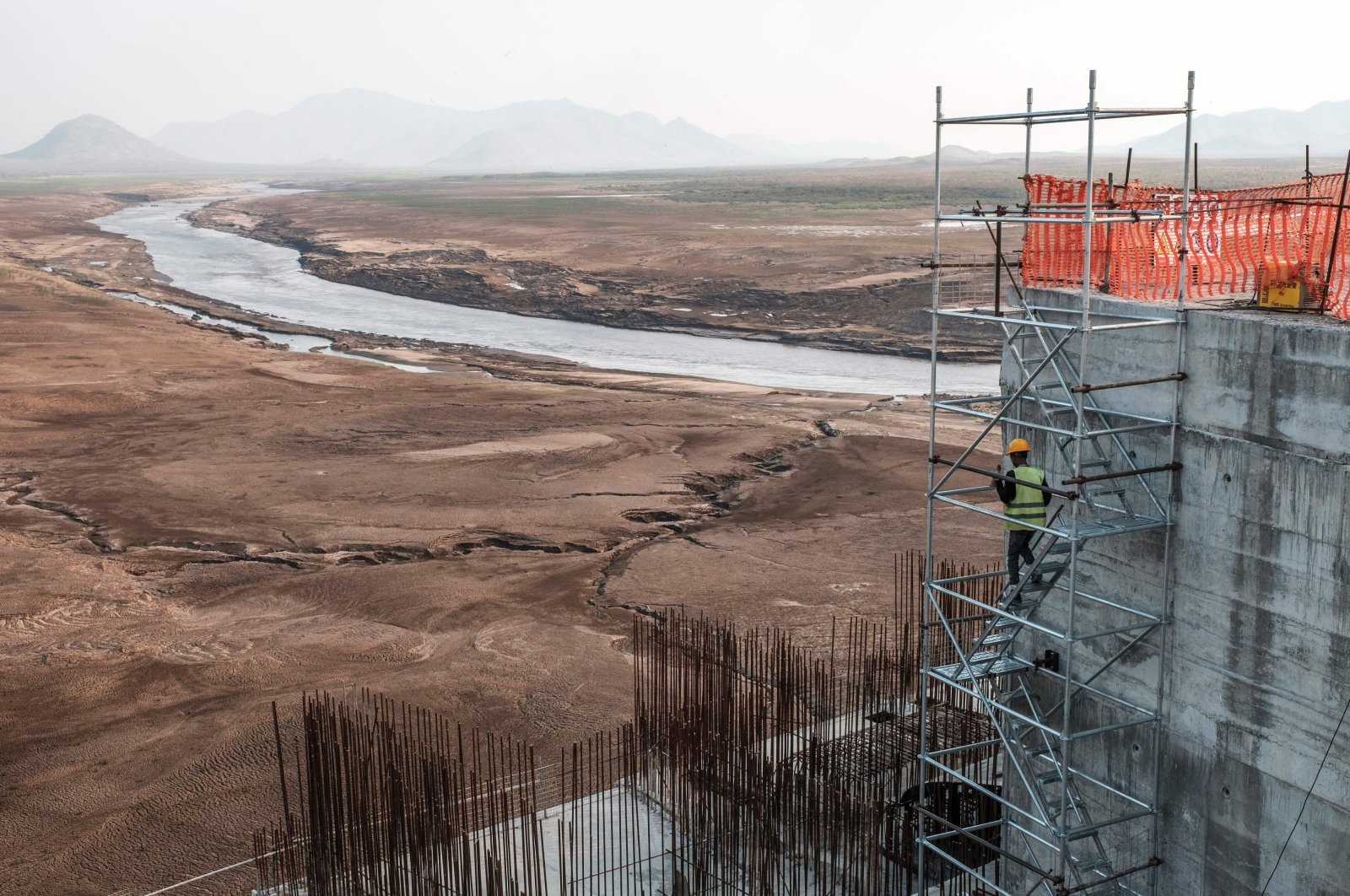 In this Dec. 26, 2019, file photo, a worker goes down a construction ladder at the Grand Ethiopian Renaissance Dam (GERD), near Guba in Ethiopia. (AFP Photo)