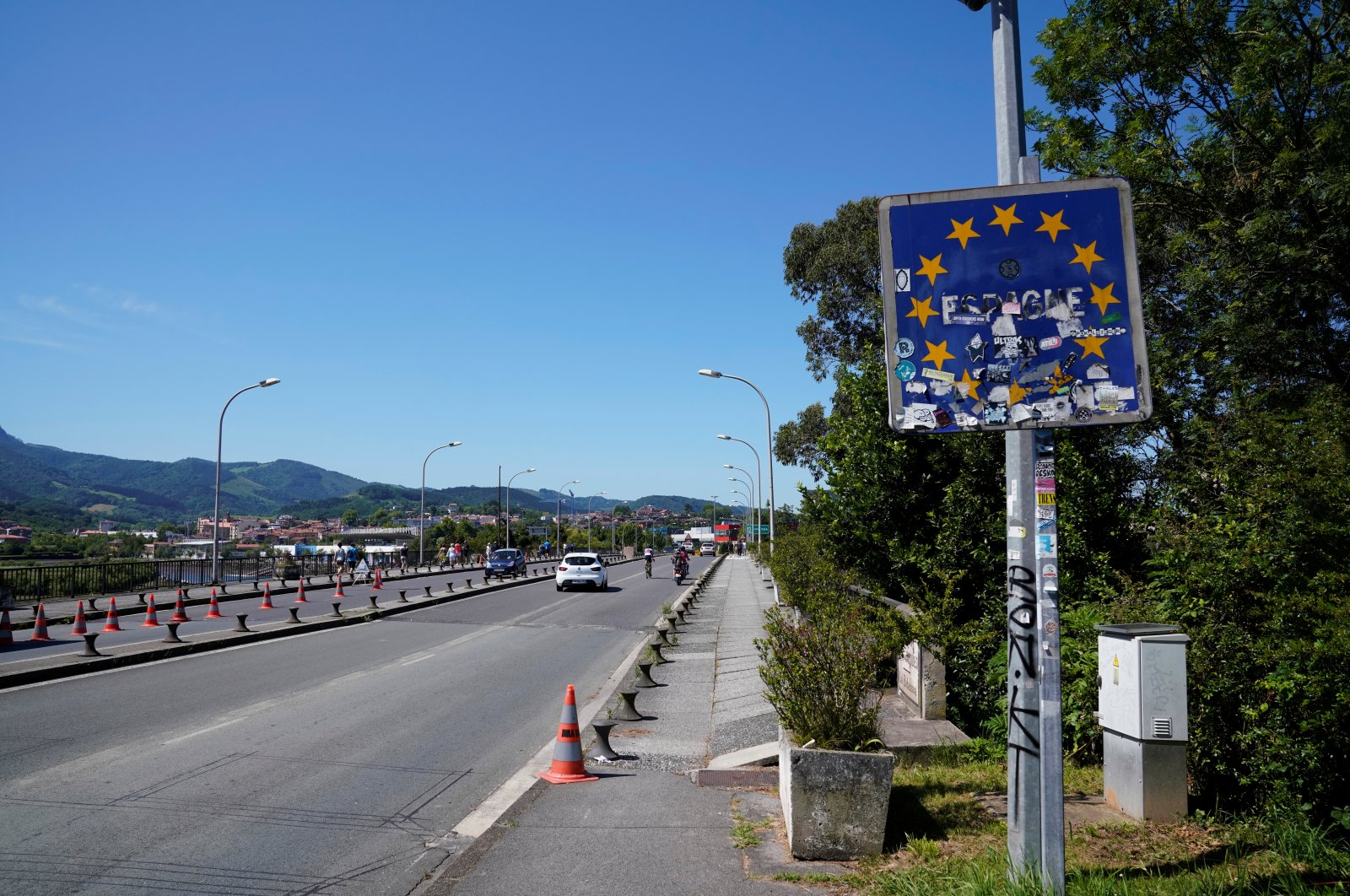 A defaced sign showing the border between France and Spain is seen as Spain reopens its borders to most European visitors, in Hendaya, France, June 21, 2020. (Reuters Photo)