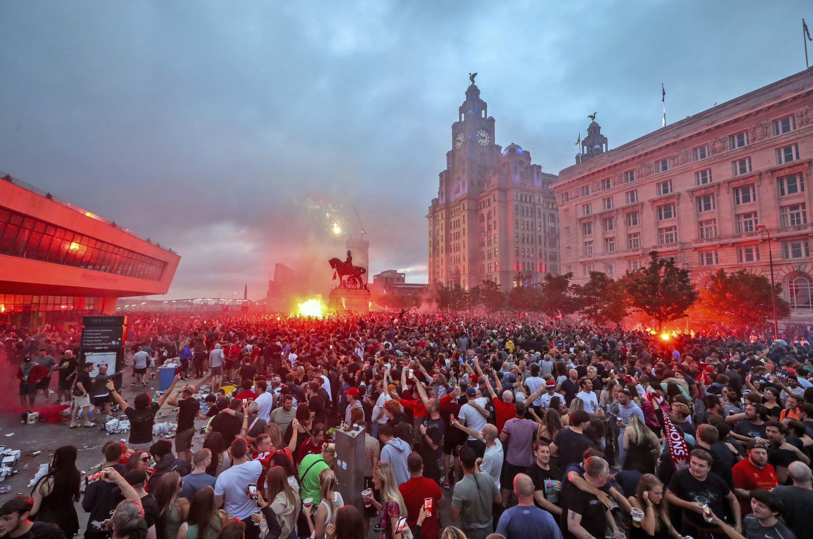 Liverpool fans let off flares outside the Liver Building in Liverpool, June 26, 2020. (AP Photo)