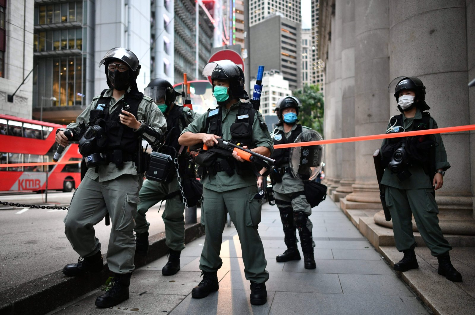 In this file photo riot police officers stand guard ahead of a pro-democracy march in the Central district of Hong Kong on June 9, 2020, as the city marks the one-year anniversary since pro-democracy protests erupted following opposition to a bill allowing extraditions to mainland China. (AFP Photo)