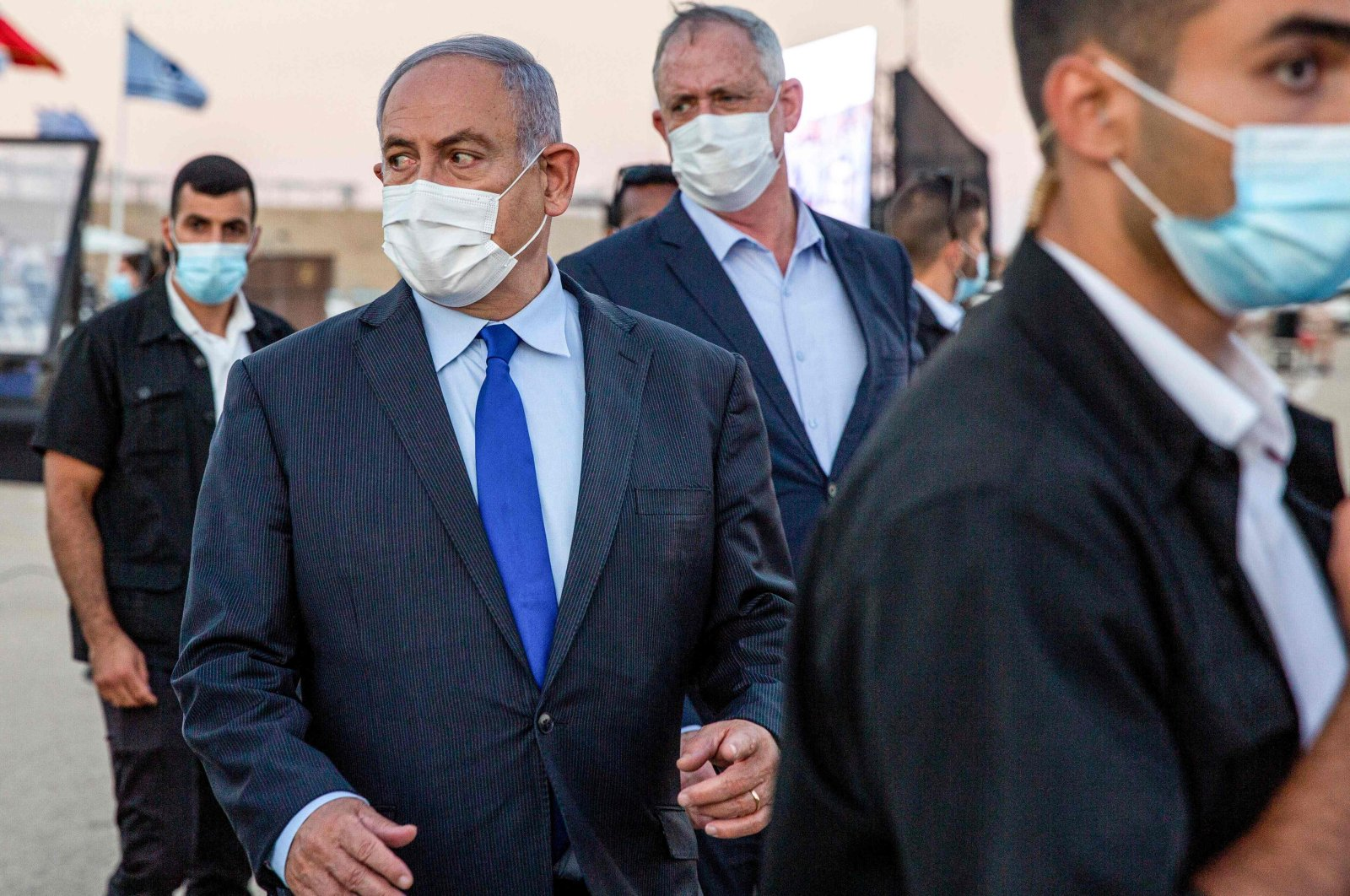 Israeli Prime Minister Benjamin Netanyahu (C-L) and his coalition partner Defence Minister Benny Gantz (C-R) arrive at a graduation ceremony for new pilots in Hatzerim air force base near the southern Israeli city of Beersheba, on June 25, 2020. (AFP Photo)