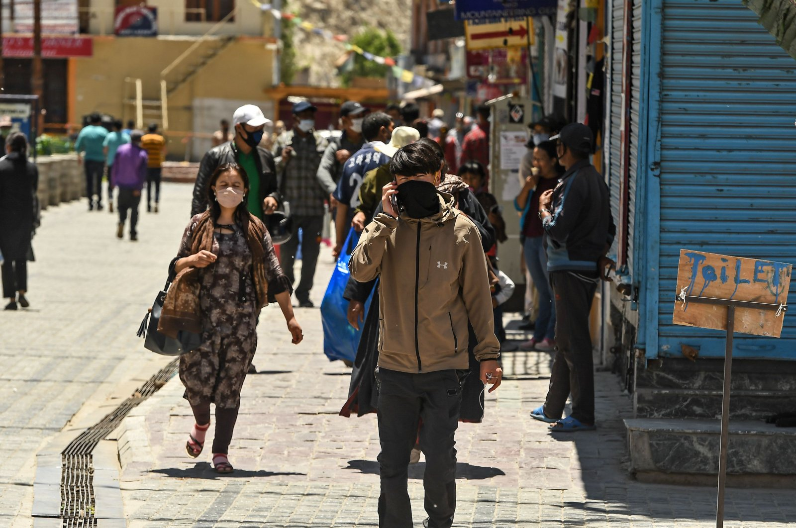 People walk at a market in Leh, the joint capital of the union territory of India's Ladakh, June 27, 2020. (AFP Photo)