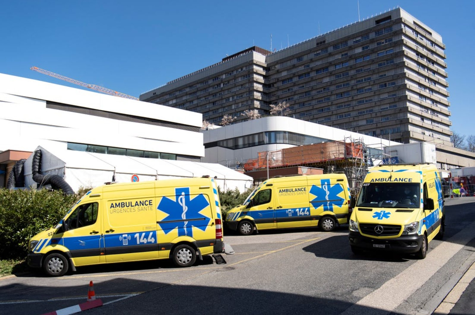 Ambulances are parked in front of a temporary space for patients at a hospital in Switzerland's Lausanne in this undated photo. (Reuters File Photo)