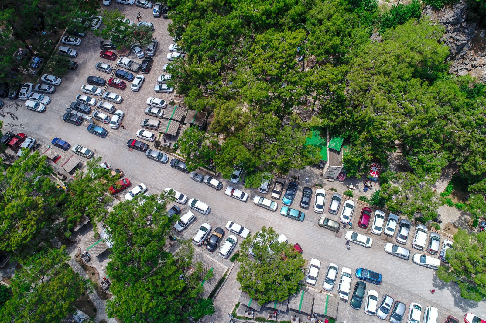 Passenger cars are seen parked at a picnic area in southern Antalya province, Turkey, June 22, 2020. (DHA Photo)