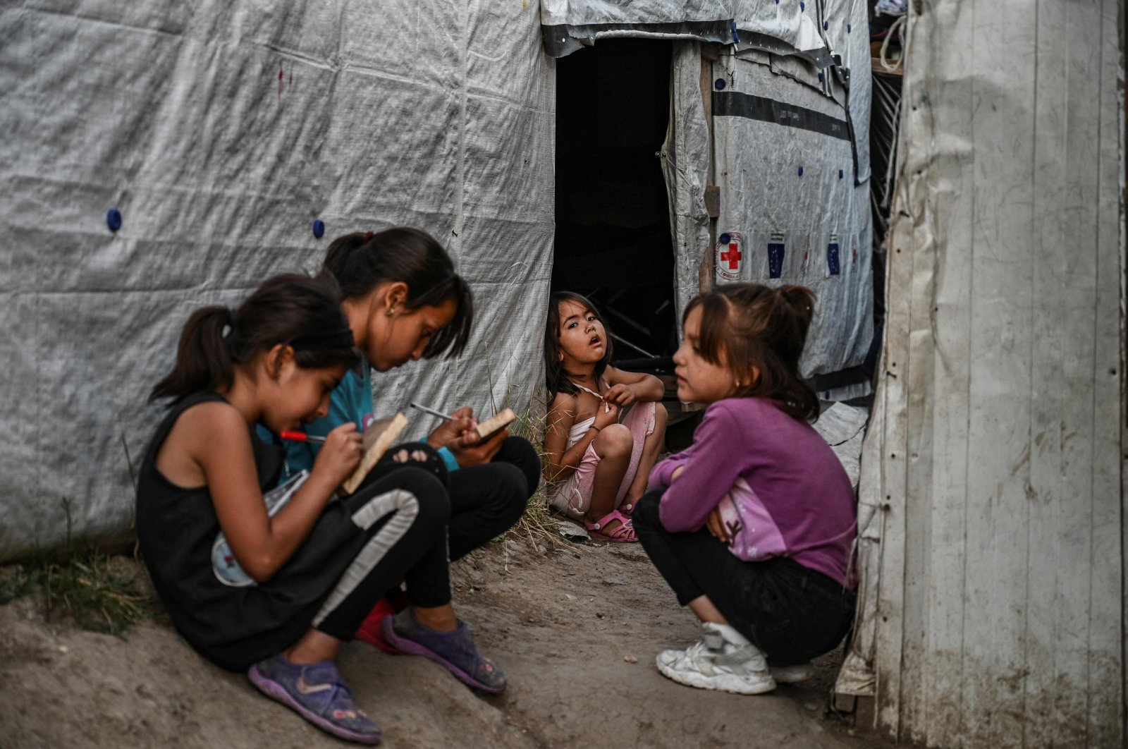 Childs are pictured in a improvised tents camp near the refugee camp of Moria in the island of Lesbos, June 21, 2020. (AFP)