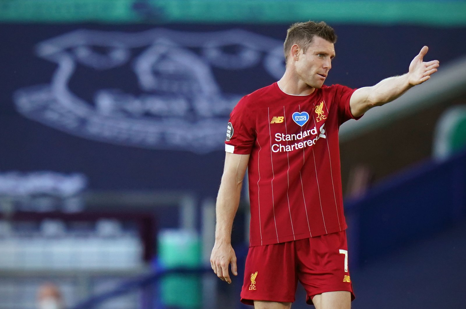 Liverpool's James Milner gestures during a Premier League match in Liverpool, England, June 21, 2020. (AFP Photo)