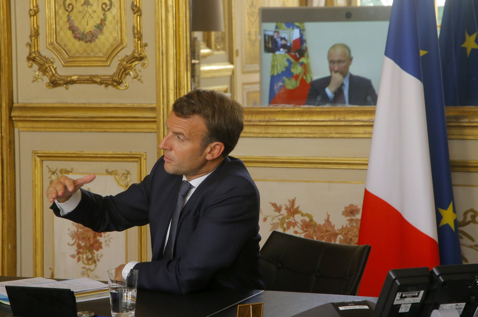 French President Emmanuel Macron talks to Russian President Vladimir Putin during a video conference at the Elysee Palace in Paris, June 26, 2020. (AP)