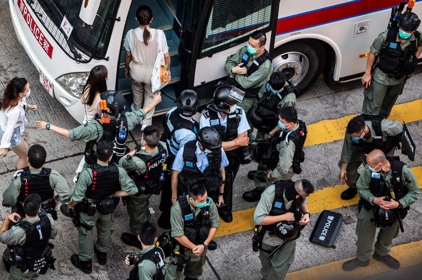 Women (L) are arrested and led onto a bus by police during a protest against China's planned national security law in Hong Kong on June 28, 2020. (AFP Photo)