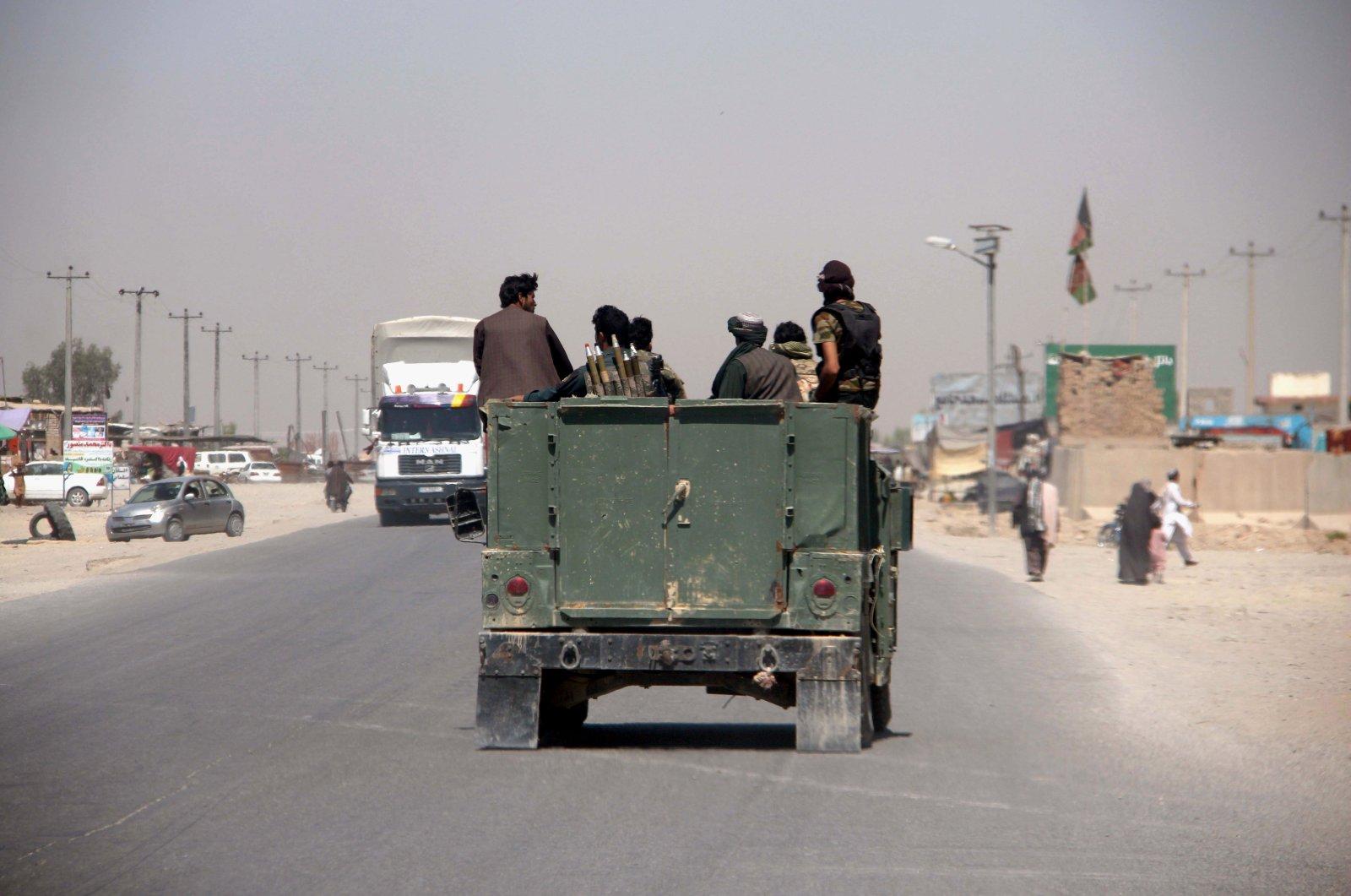 Afghan security officials patrol on a highway in Helmand, Afghanistan, June 14, 2020. (EPA Photo)