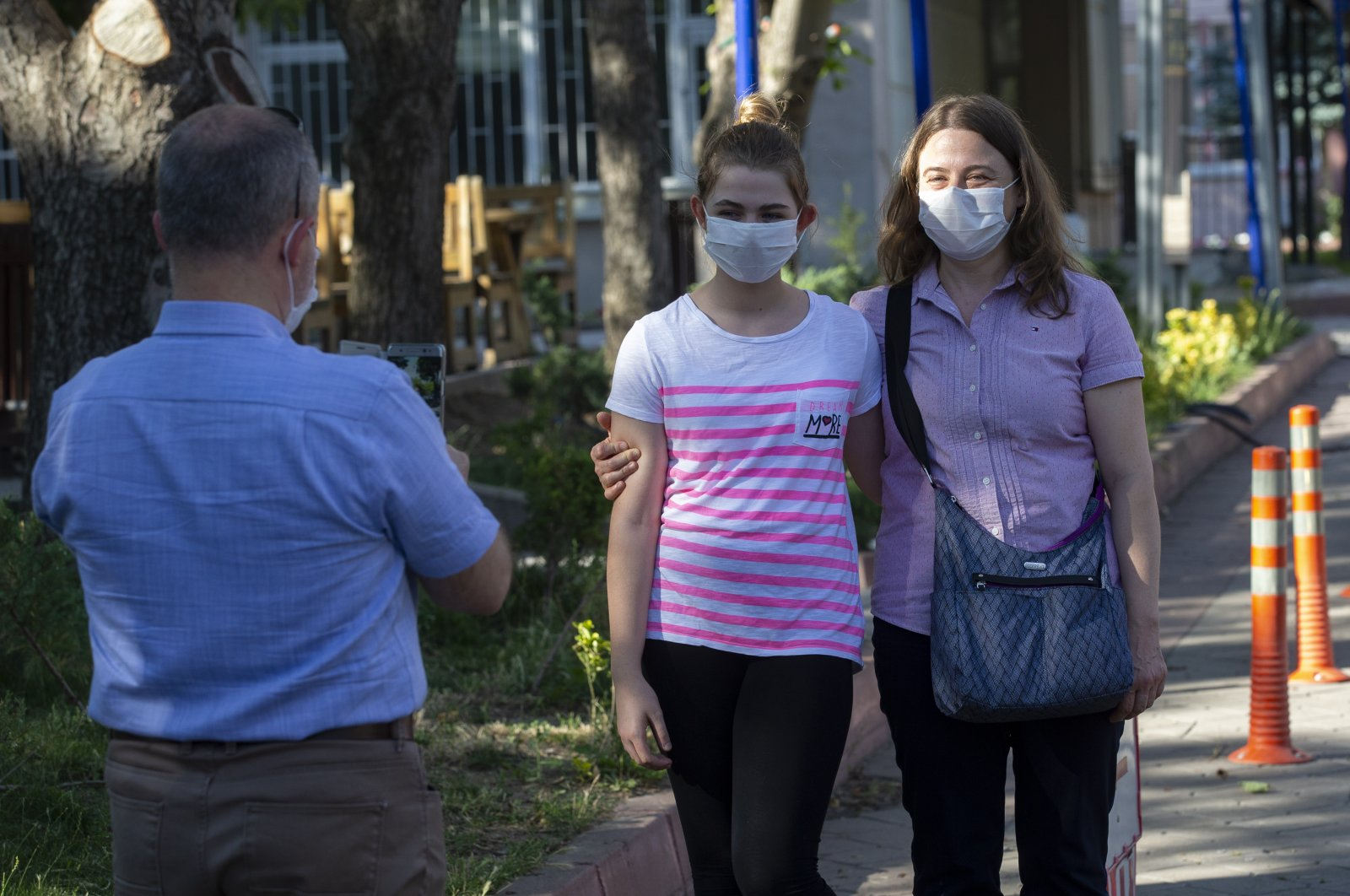 A mother and daughter pose for a photo, wearing face masks to protect against COVID-19, after the nationwide Higher Education Institutions Exam (YKS), Turkey, June 28, 2020. (AA Photo)