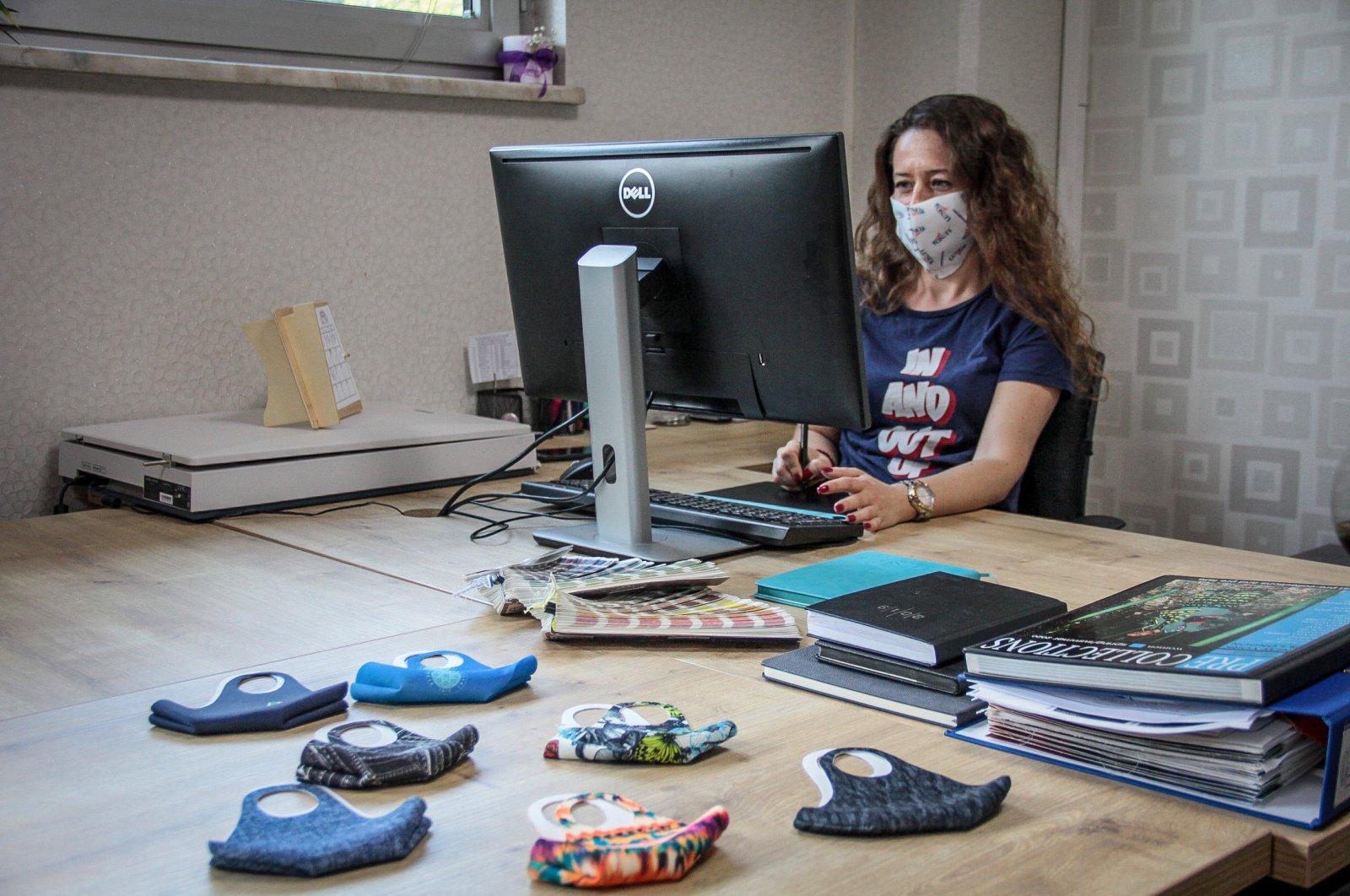 A woman works at a factory producing antibacterial face masks in Bursa, Turkey, June 27, 2020. (AA Photo)