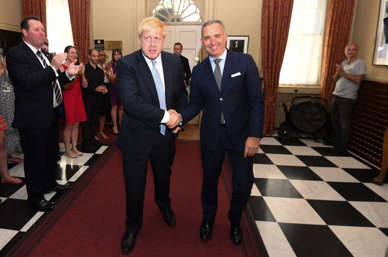 Britain's Prime Minister Boris Johnson (L) shakes hands with Cabinet Secretary Mark Sedwill (R), head of the Civil Service, in 10 Downing Street, London, England, July 24, 2019. (AFP Photo)