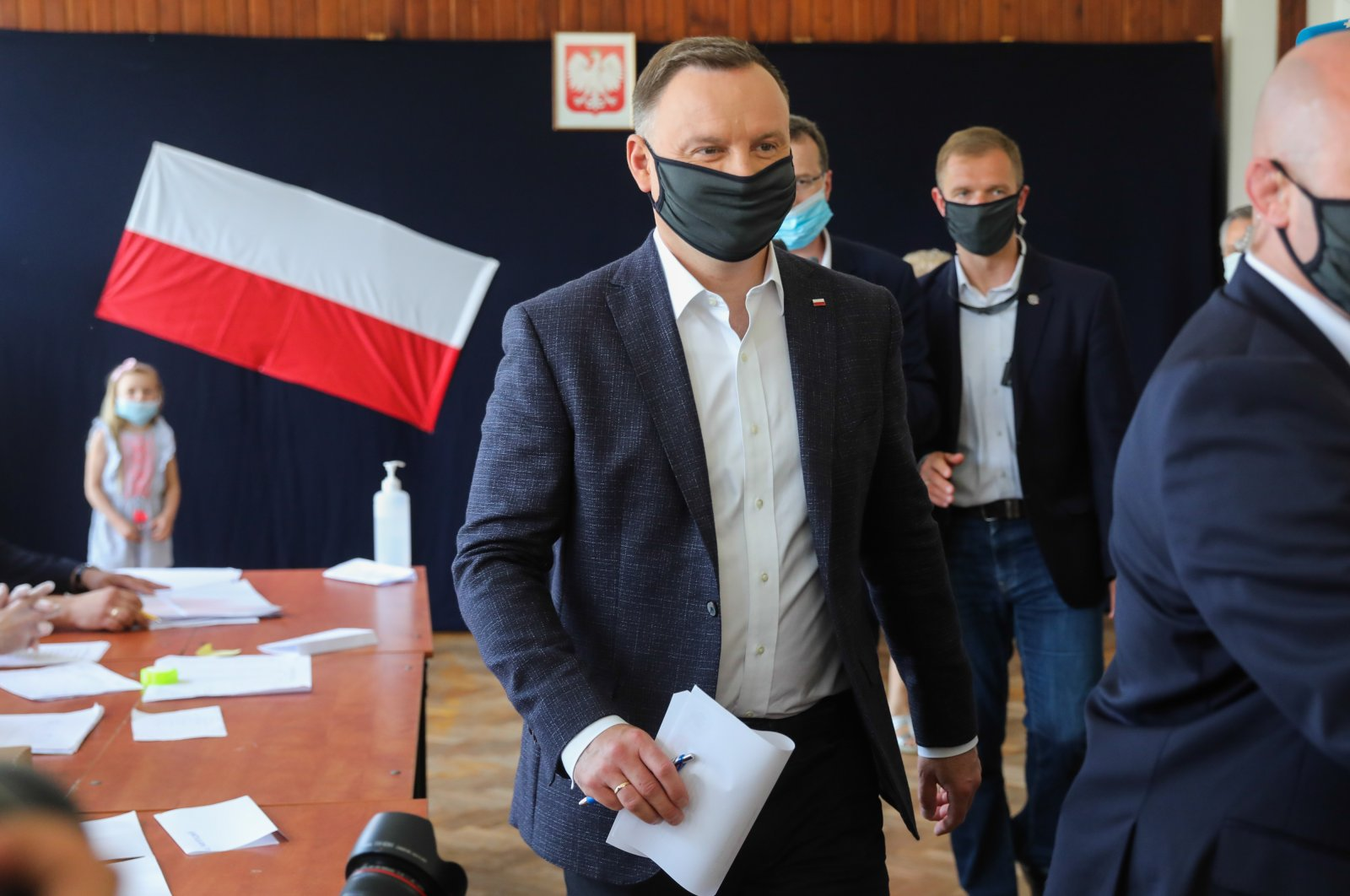 President Andrzej Duda, wearing a protective face mask, casts his ballot during the presidential election at a polling station in Krakow, Poland, June 28, 2020. (AA Photo)
